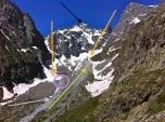 """Pasillo"" de avance del Glaciar Noir (naranjas). Morrena lateral, en detalle (verde). Torrente de deshielo (gris). Frente del Glaciar Noir (violeta). Pico Coolidge (negro), en cota 3.775 mts"